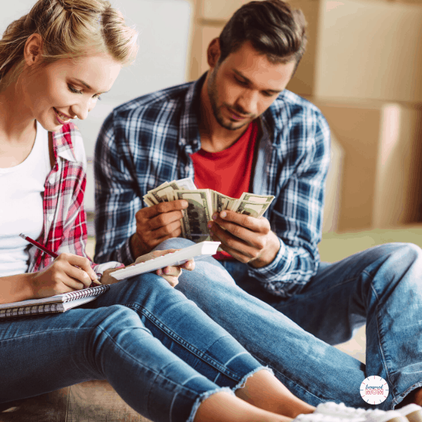 couple looking at bills, money for Over 100 Ways to Save Money