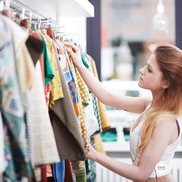 woman shopping clothing rack for Over 100 Ways to Save Money