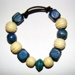Bracelet     Size  Medium/Adult Female   3.5 in to 4 in Made with Leather Cord, 12 Wood Beads and 1 Plastic Bead Price: $5.00