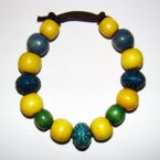 Bracelet     Size Medium/Adult Female  3.5 in to 4 in Made with Leather Cord, 12 Wood Beads and 3 Plastic Beads Price: $5.00
