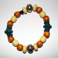 Bracelet     Size Medium/Adult Female   4 in Made with Leather Cord 16 Wood Beads and 5.4 Plastic Beads (.4 are small beads surrounding the two teal/lined beads) Price: $5.00