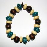 Bracelet     Size  Medium/Adult Female   4 in Made with Leather Cord, 18 Wood Beads and 6 Plastic Beads Price: $5.00