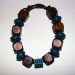 Bracelet     Size   Medium/Adult Female   3.75 in to 4.25 in Made with Leather Cord, 8 Wood Beads and 7 Plastic Beads Price: $5.00