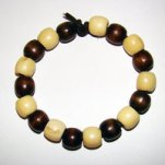 Bracelet     Size   Medium/Adult Female   3.5 in  Made with Leather Cord and 18 Wood Beads Price: $5.00