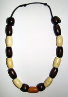 Necklace     Size Small/Child  8.5 in to 9.5 in Made with Leather Cord and 17 Wood Beads Price: $7.00