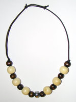 Necklace     Size   Small/Child   7.5 in to 10 in Made with Leather Cord, 14 Wood Beads and 1 Plastic Bead Price: $7.00