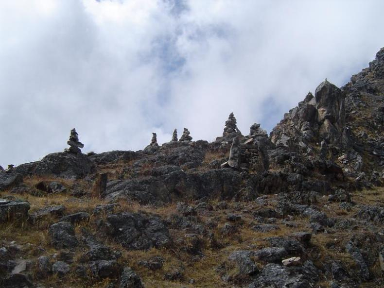 Climbing up some of the Huaytapallana mountain range which lies in the Junín Region in the Andes of Peru close to the city of Huancayo to stack rocks and give gifts to the Gods of the mountain.