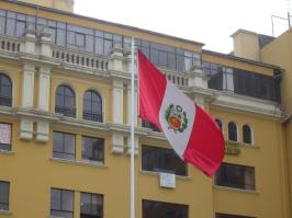 The Peruvian flag flying in the Plaza Mayor of Lima, Peru.