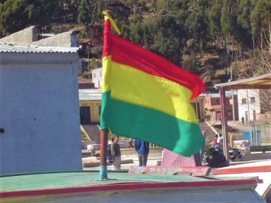 The Bolivian flag flying on one of the water taxis.