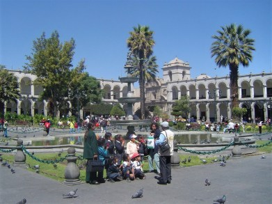 Peruvians getting ready to take a group photo in front of the fountains of La Plaza de Armas.