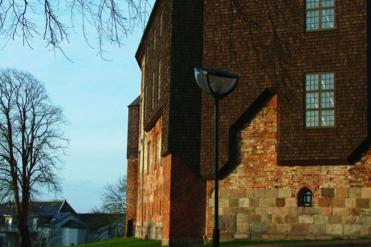 Kolding Castle was restored using a different set of materials than what was used to build the original castle. You can easily see some of the original brick foundation that contrasts the wooden material used in the restoration.