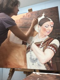 Sunny in her studio painting the Shakti Temple Dancer. 2021
