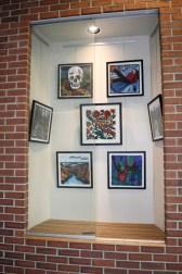Display case with artwork by Laurel Macdonald