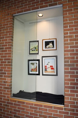 Display case with artwork by Gina Brostmeyer