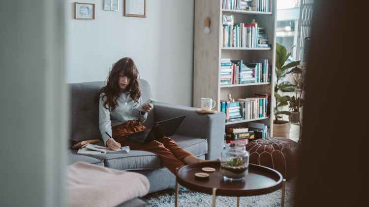 photo of woman sitting on couch