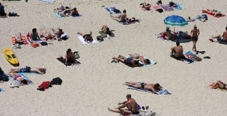 Beachgoers tanning