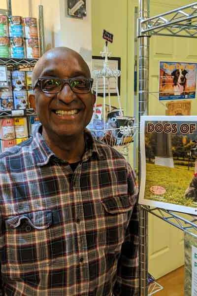 Tré Bone owner, Serge, and the 2020 Dogs of St. Johns Calendar