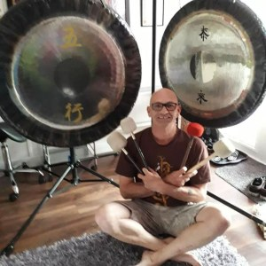 Gong baths with crossed mallets in Manchester