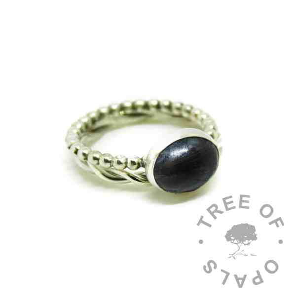 lock of hair ring with vampire black resin sparkle mix on a bubble band, shown with a twisted wire stacker