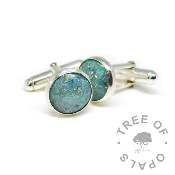 cremation ashes cufflinks mermaid teal sparkles. Solid sterling silver setting