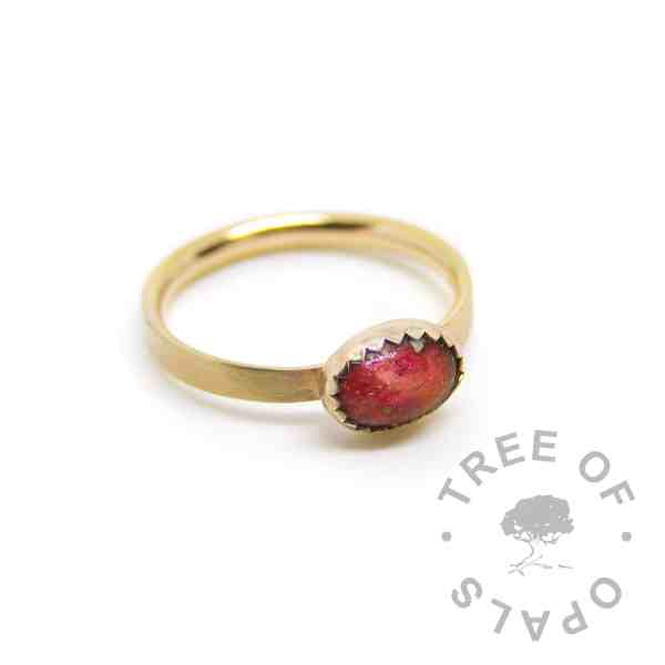 gold umbilical cord ring red. Dragon's Blood Red resin sparkle mix, solid 14ct gold brushed band. Mockup