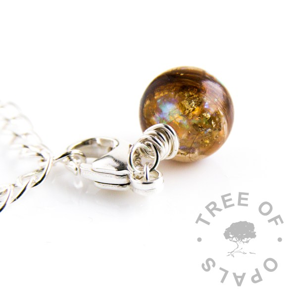 lock of hair pearl dangle charm with opalescent flakes and gold leaf, lobster claw setting, Thomas Sabo charm
