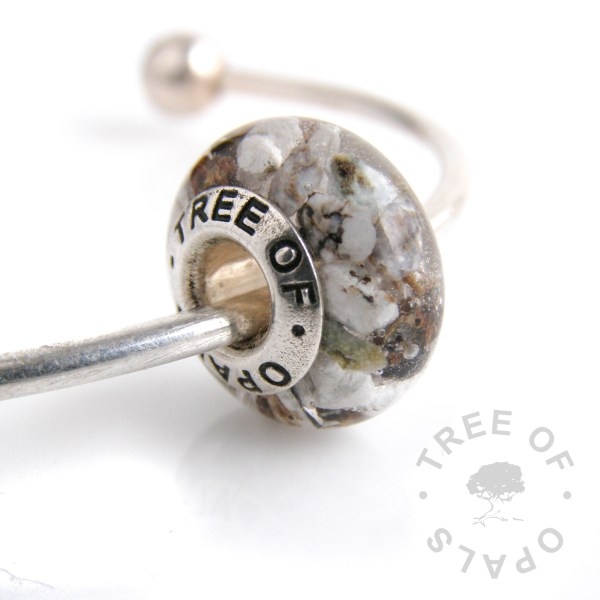 cremation ash charm bead with crystal clear resin and stunning large cremains that look like semi-precious stones. We don't grind down pieces like this as they would for glass charms