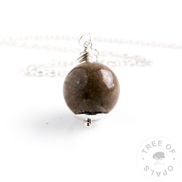 cremation ash pearl with crystal clear resin and naturally very dark cremains, hand wire wrapped with solid sterling silver wire
