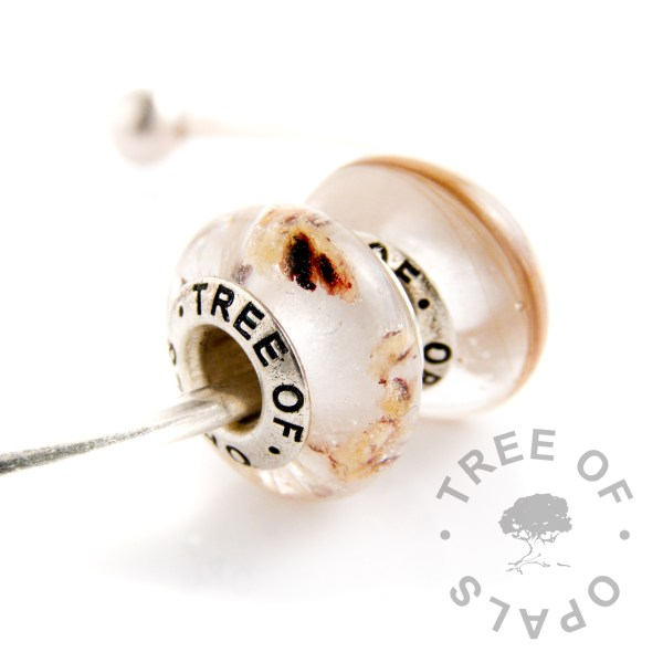 charm bead duo cord and hair, classic clear resin (no shimmers, birthstones or colours etc). These slide right onto European snake chains, bangles and necklaces like Trollbead and Pandora bracelets