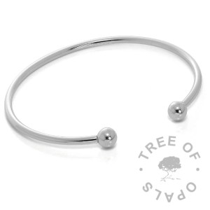 torque charm bangle made of solid sterling silver, hollow silver tube and balls (one removable)