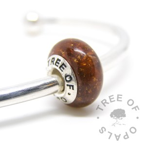 umbilical cord placenta bead in resin, genuine rose gold leaf and bronze shimmer with a solid sterling silver Tree of Opals branded core umbilical cord charm, for Pandora bracelets, white background cutout watermarked image, copyright 2017