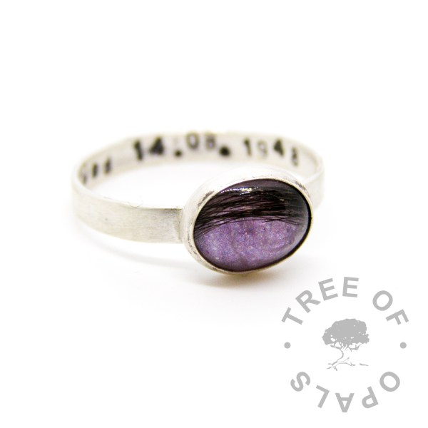 lock of hair ring with orchid purple sparkle background galaxy effect, brushed solid sterling silver band and stamping
