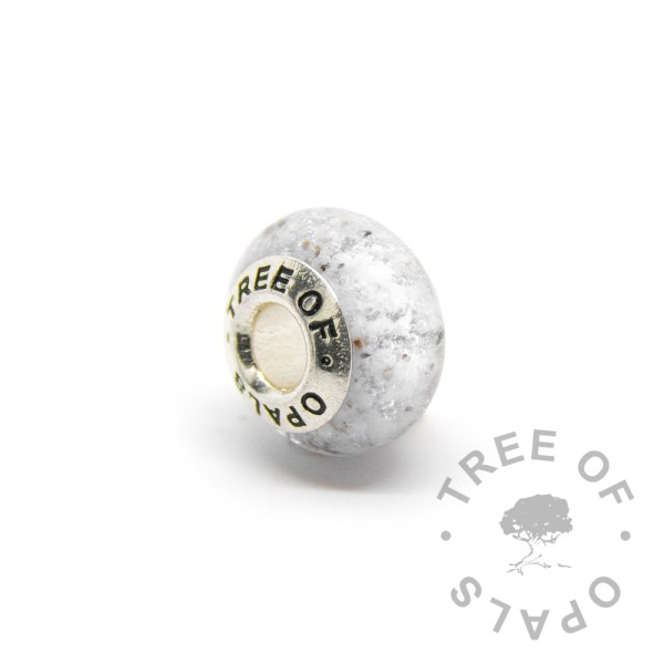 clear glass cremation charm set with solid sterling silver Tree of Opals core