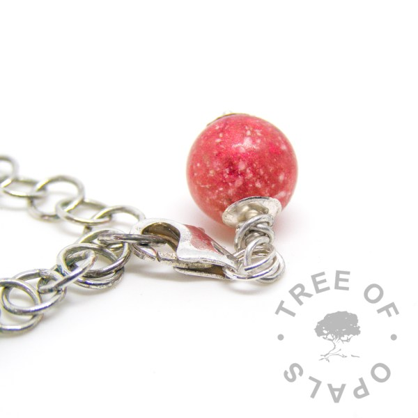 top view of a dragon's blood red cremation pearl dangle charm with solid sterling silver lobster claw setting for Thomas Sabo style bracelets and necklaces Tree of Opals