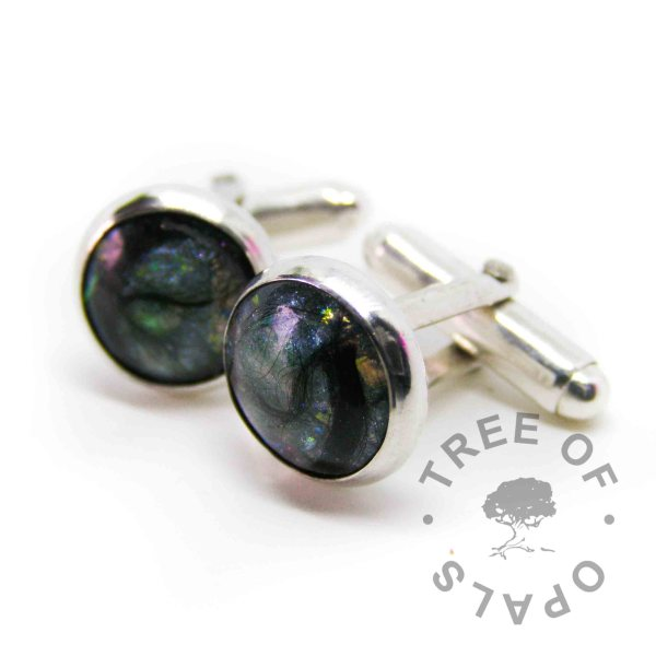 lock of hair cufflinks mermaid teal in handmade solid sterling silver setting. Black fur swirled round in the resin at client's request
