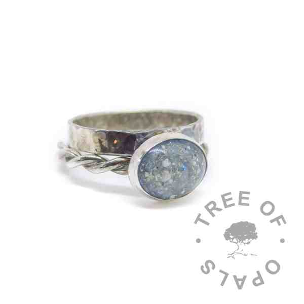 cremation ash ring with Aegean blue sparkle mix on twisted wire band with wide band textured stacking ring