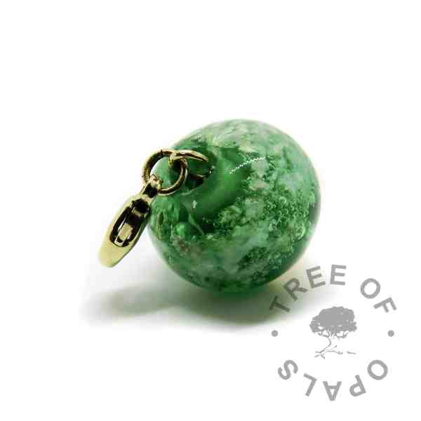 gold glass cremation orb green with lobster claw setting