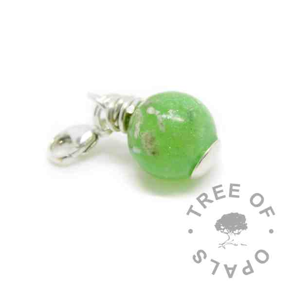 cremation ash pearl dangle charm with basilisk green resin sparkle mix. Solid sterling silver handmade wire wrapped setting, new style flat base with lobster clasp dangle setting for Thomas Sabo style necklaces and bracelets