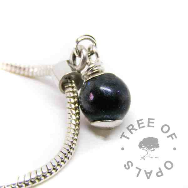 lock of hair pearl vampire black resin sparkle mix and black fur, wire wrapped by hand in solid sterling silver and set as a European dangle charm for Chamilia and Pandora bracelets. Shown on a 3mm snake chain. Please note that pearls are now made with a flat base which is attached to a headpin for extra security, they no longer have the silver dot at the bottom.