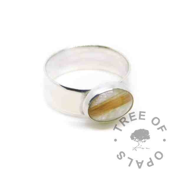 lock of hair memorial ring with unicorn white resin sparkle mix, no birthstone. Solid sterling EcoSilver handmade setting with 6mm wide shiny band style. 10x8mm cabochon (stone) blonde hair in resin ring.