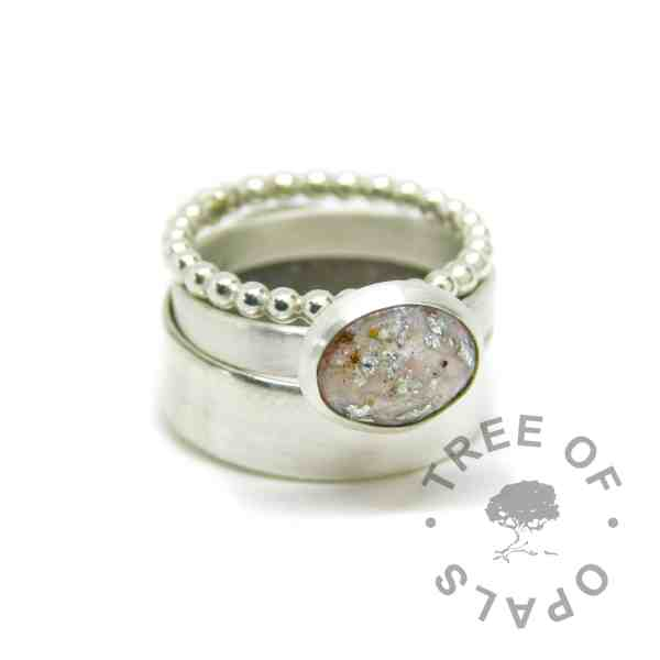 ring stack with fairy pink cremation ash ring with silver leaf on brushed wire band with bubble wire and 6mm wide shiny stacking rings (cremation ash ring). Solid 925 sterling EcoSilver and 935 argentium silver handmade rings. 10x8mm bezel cup rubbed over the cabochon for security.