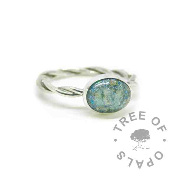 Remade from broken ring by another jeweller. Mermaid teal cremation ash ring on twisted wire band with textured stacking ring (umbilical cord ring). Solid sterling EcoSilver handmade ring. 10x8mm bezel cup rubbed over the cabochon for security.