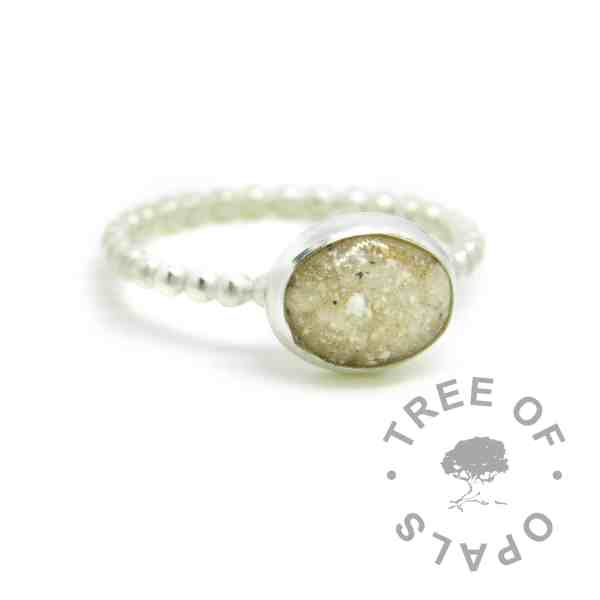 classic cremation ash ring on a handmade Argentium silver bubble wire band stacking ring. 10x8mm cabochon with naturally pale cremation ashes and crystal clear resin.