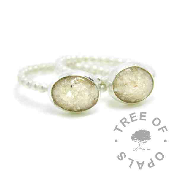 classic cremation ash rings on handmade Argentium silver bubble wire band stacking rings. 10x8mm cabochons with naturally pale cremation ashes and crystal clear resin.