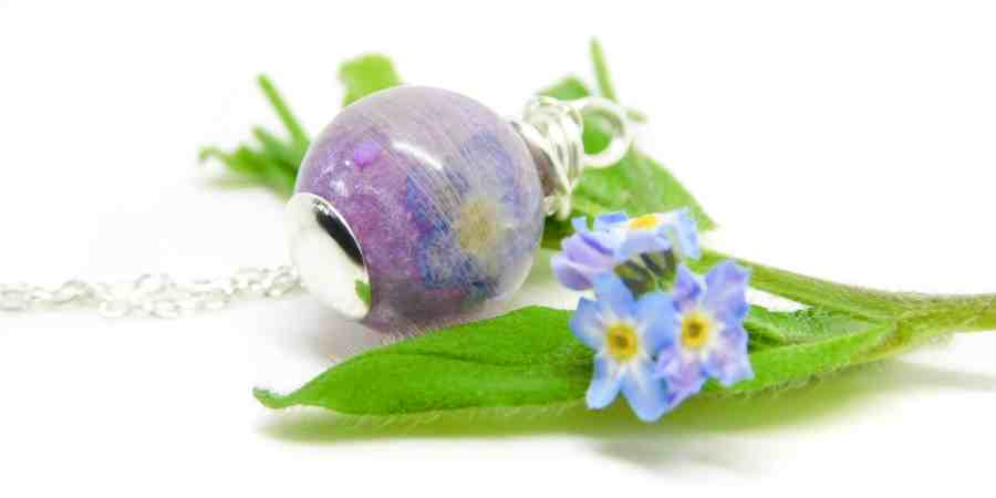 forget me not lock of hair pearl with naturally grey white hair, orchid purple resin sparkle mix in an 11mm sphere. Flat base, solid sterling silver wire wrapped by hand shown with matinee length leightweight chain