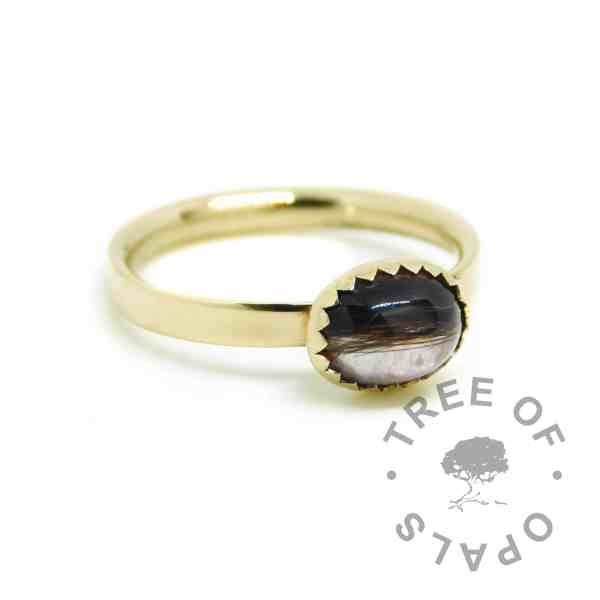 solid gold lock of hair ring, shiny band 14ct gold hallmarked stacking ring. 8x6mm serrated cabochon with brunette lock of hair and unicorn white custom resin sparkle mix.