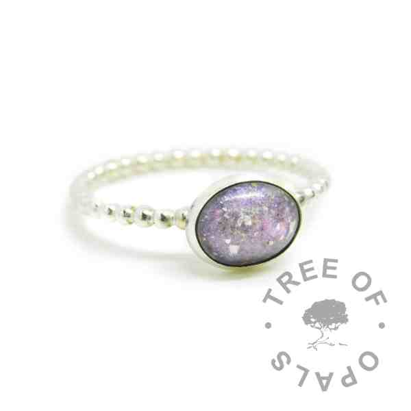 Cremation ash ring with orchid purple resin sparkle mix, no birthstone. 2mm wide bubble wire ring band handformed with solid 935 Argentium silver (slightly purer than sterling silver), and 10x8mm pure silver bezel cup. Watermarked copyright Tree of Opals memorial jewellery image