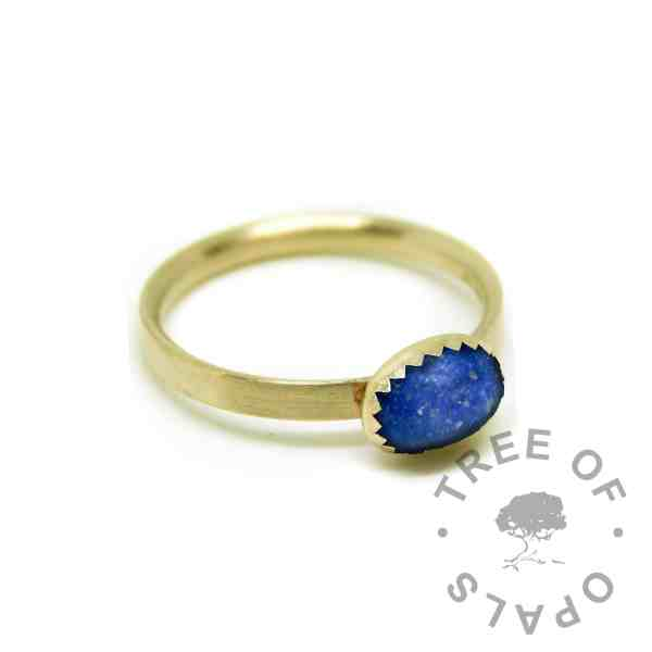 Solid gold cremation ash ring with Aegean blue resin sparkle mix. Brushed band gold ring solid 14ct gold with serrated setting
