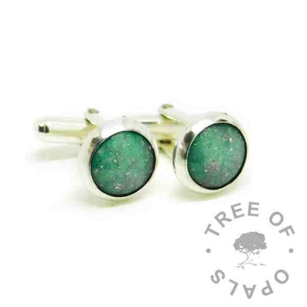 cremation ash cufflinks with basilik green resin sparkle mix. Solid sterling silver setting