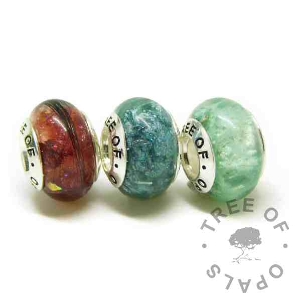 charms with Tree of Opals core, dragon's blood red lock of hair charm and mermaid teal and angelic aqua resin sparkle mix cremation ashes charm beads